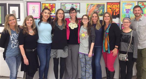 Art teachers posing for a photo at the art show