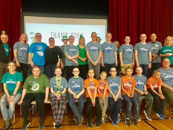 St. Baldrick's participants posing for a photo after they had their heads shaved