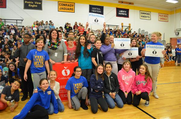 Mrs. Kedzierski with her students in the gym after winning the Golden Apple Award