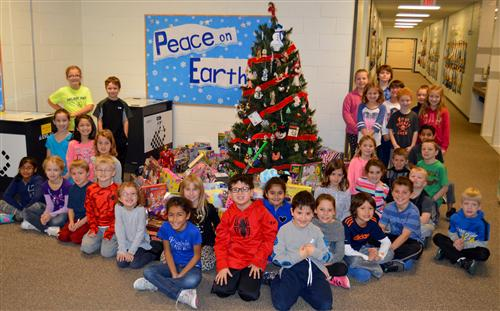 Prairie students posing in front of donated toys