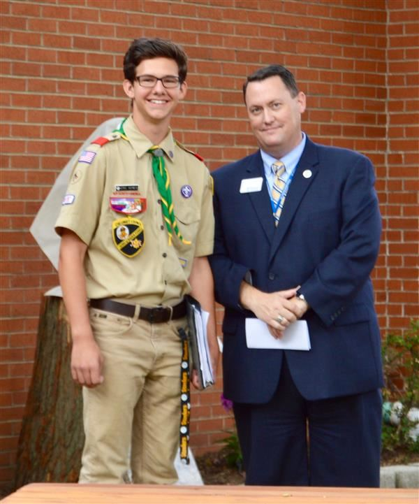 Dr. Skogsberg with Eagle Scout Eric Kenes in the courtyard