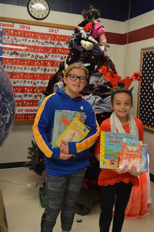Students holding book drive donations