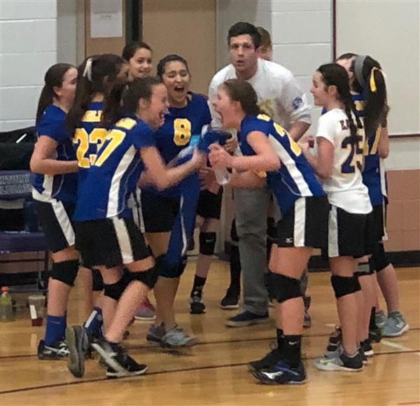 Volleyball team in a huddle
