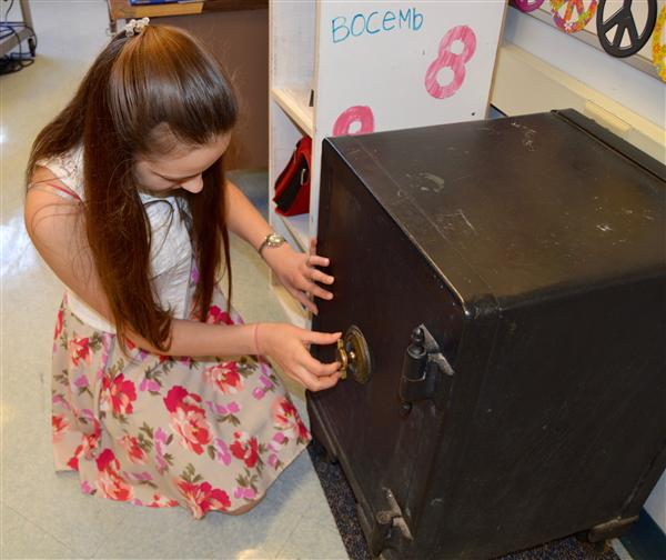 Student opening safe inside classroom