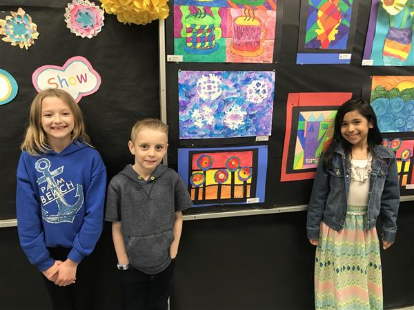 Students at the art show