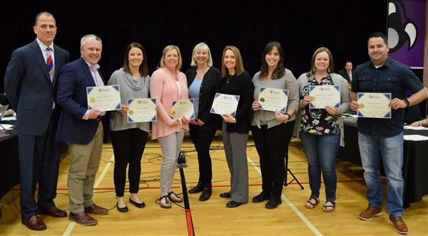 A group of educators from Jerling Junior High being recognized for an award